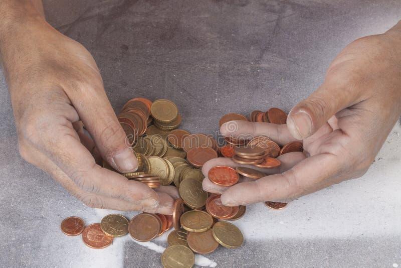 Pobres y monedas fotografía de archivo