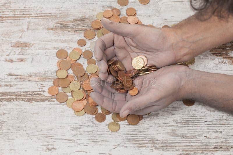 Pobres y monedas foto de archivo