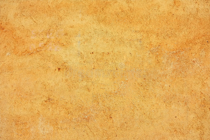 Pobrudzony, textured, kolor żółty barwiąca betonowa ściana fotografia stock