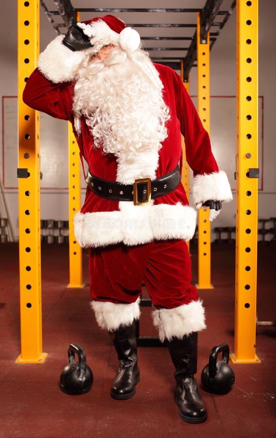 Pocący się, zmęczony Święty Mikołaj fotografia royalty free