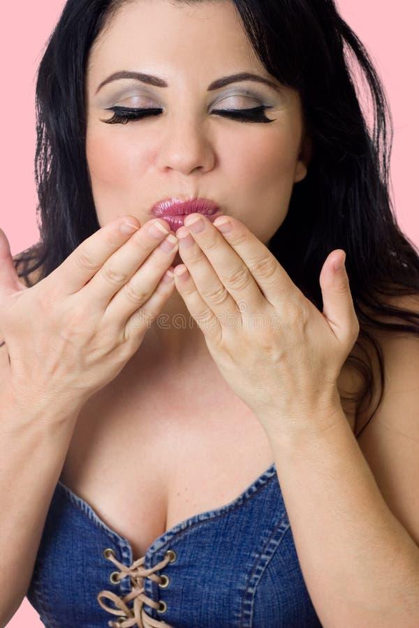 pocałunek podmuchowa kobieta fotografia stock