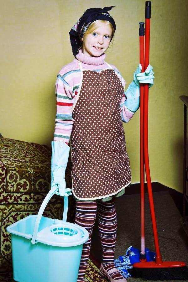 Poca señora de la limpieza fotografía de archivo libre de regalías