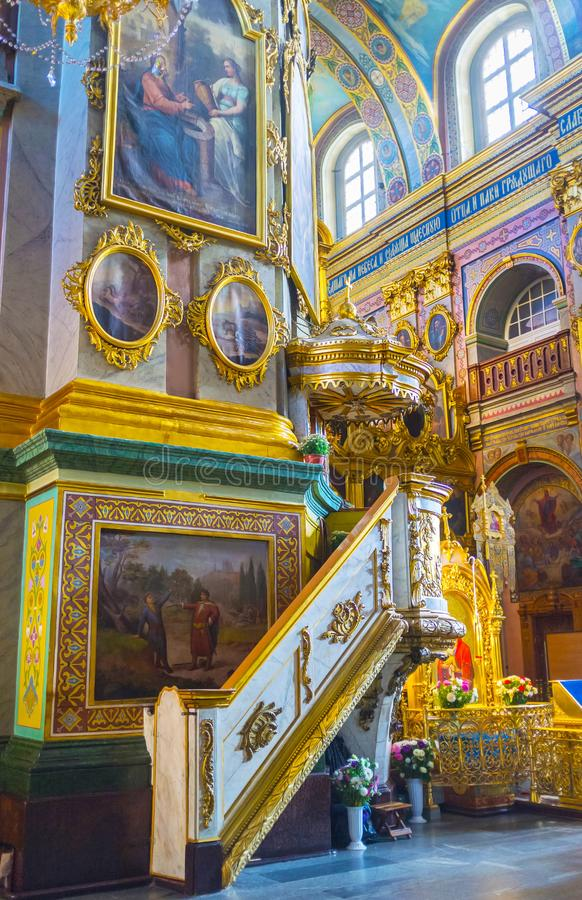 The pulpit of Dormition Cathedral. POCHAYIV, UKRAINE - AUGUST 30, 2017: The pulpit of Dormition Cathedral decorated with golden bas reliefs, on August 30 in royalty free stock photos