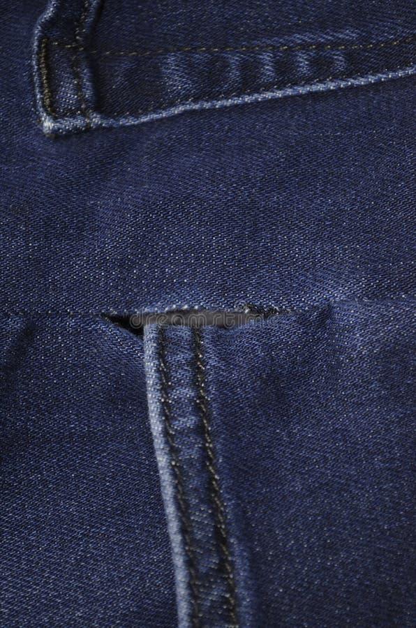 Poche de jeans avec le trou photo stock