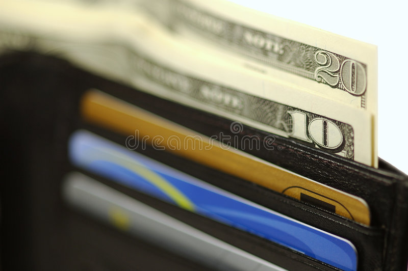 Pochette avec de l'argent et des cartes photos stock