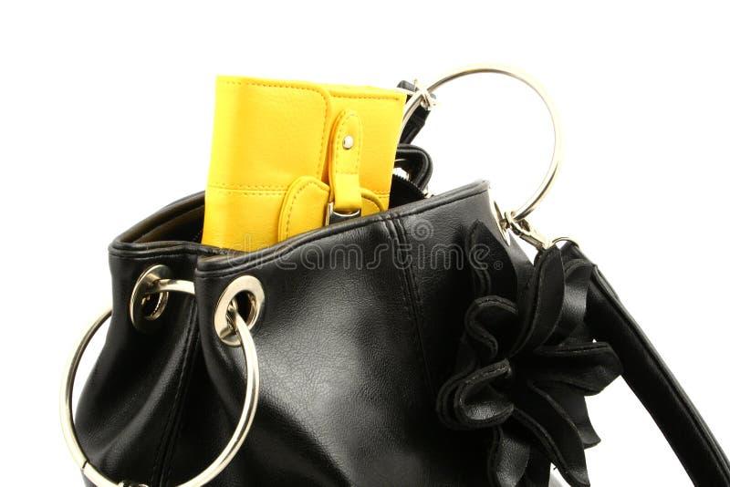 Pochette dans un sac image libre de droits