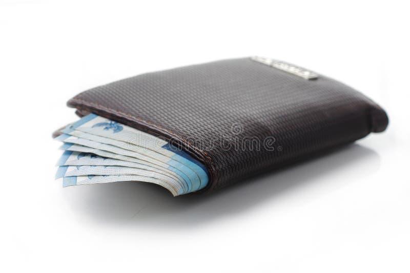 Pochette et argent au-dessus de blanc images libres de droits