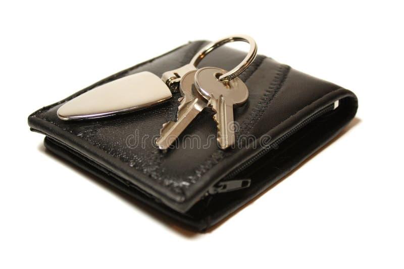 Pochette et clés photographie stock libre de droits