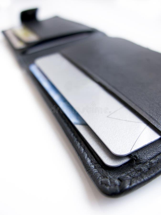 Pochette par la carte de crédit images stock