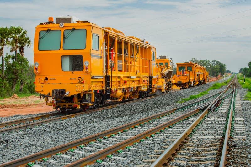 Pociąg - pojazd, Frachtowy transport, lokomotywa, linia kolejowa Ca obrazy stock