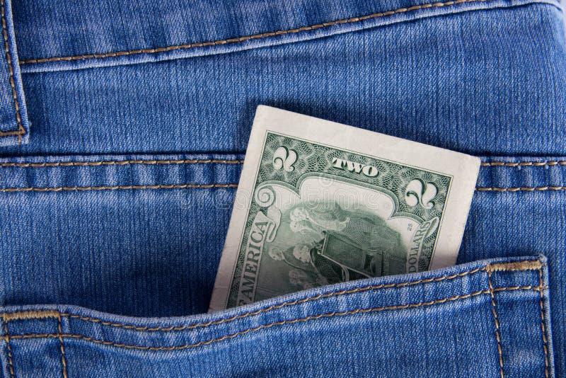 pocket dollar jeans två royaltyfri fotografi