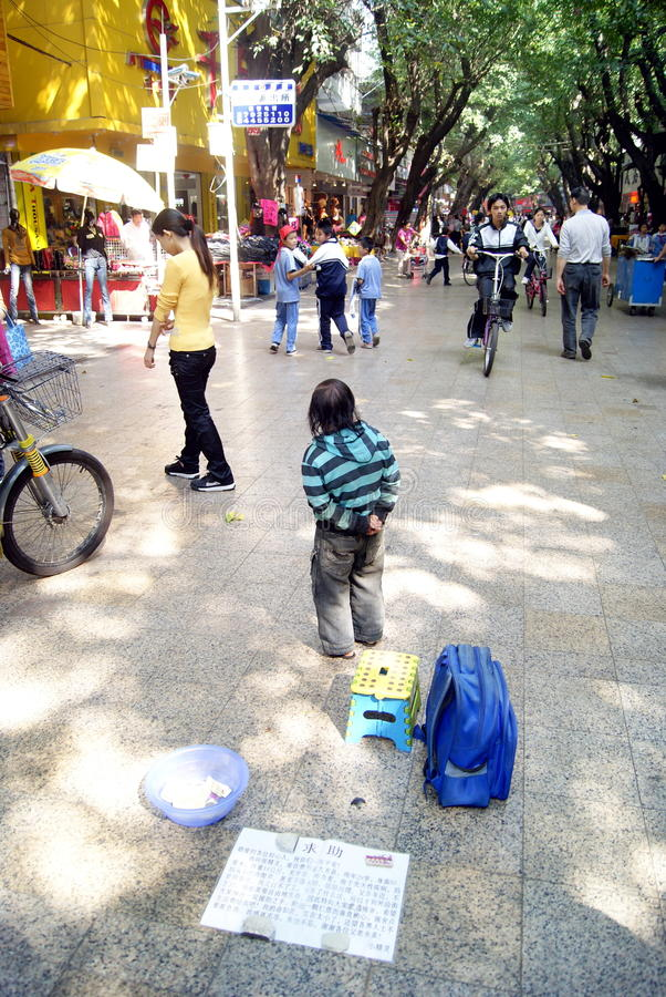 Pocket dwarfs begging. November 28, 2011, China shenzhen xixiang pedestrian mall, a small pocket dwarves, in begging. The small pocket dwarf, age 29 years old stock images