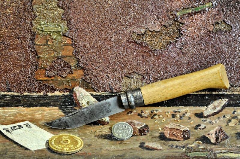 Pocket folding antique knife natural wood handle cash money stone royalty free stock image
