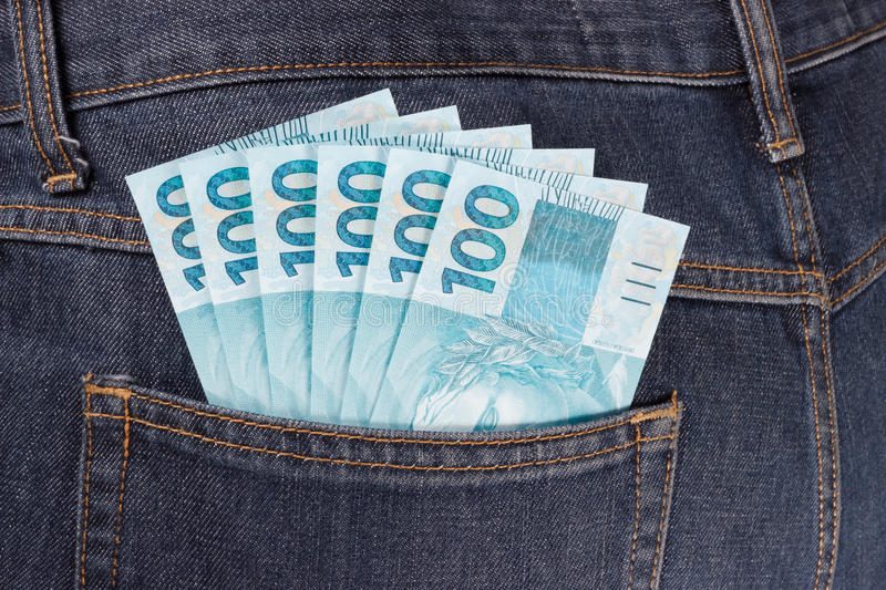 Pocket full of brazilian money stock photography