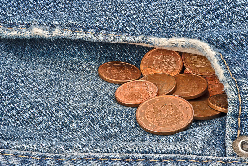 Pocket-money. EURO-Cents coming out of jeans pocket royalty free stock images