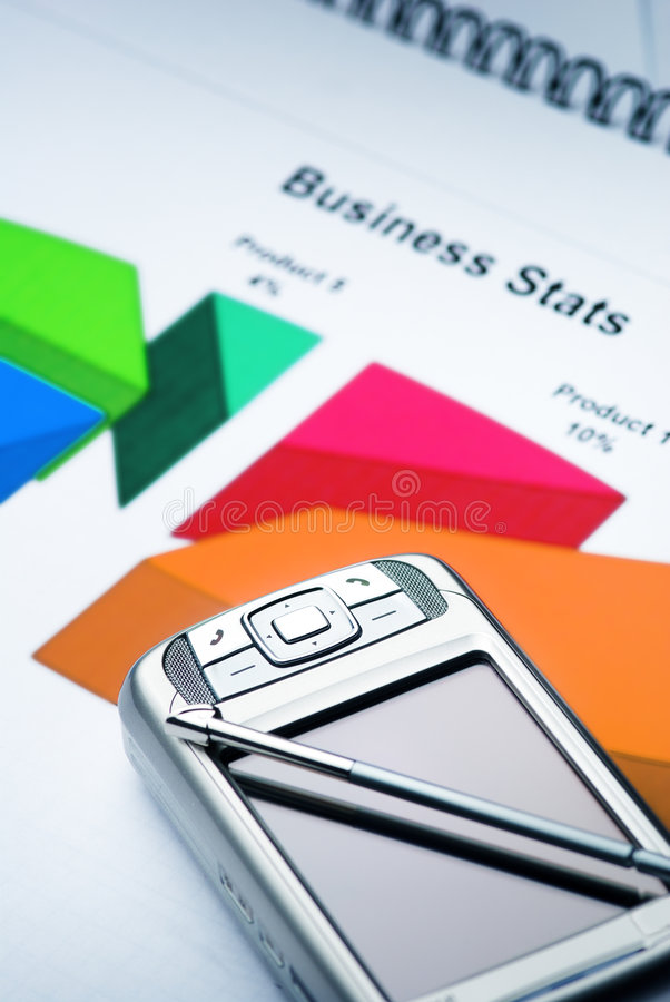 Pocket PC on the Graph. Pocket PC on the Business papers with Graph royalty free stock photo