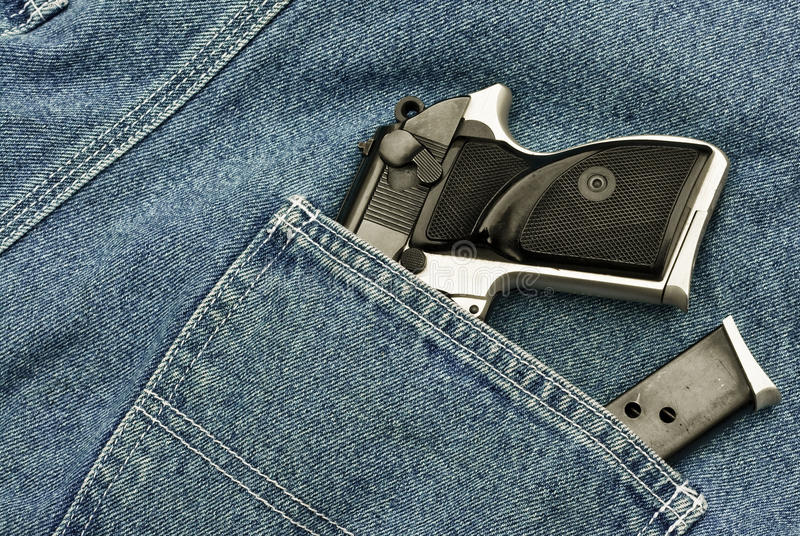 Download Pocket pistol and magazine stock image. Image of denim - 19498887
