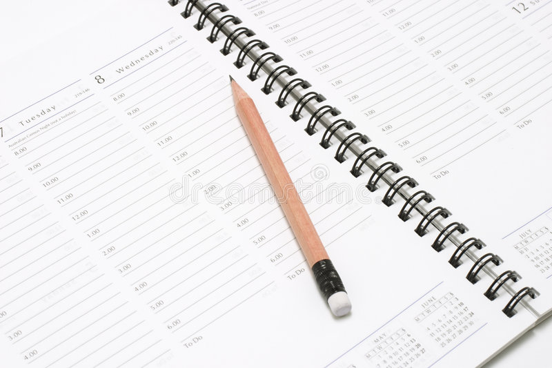Pocket Planner with Pencil. Closeup of Pocket Planner with Pencil royalty free stock image