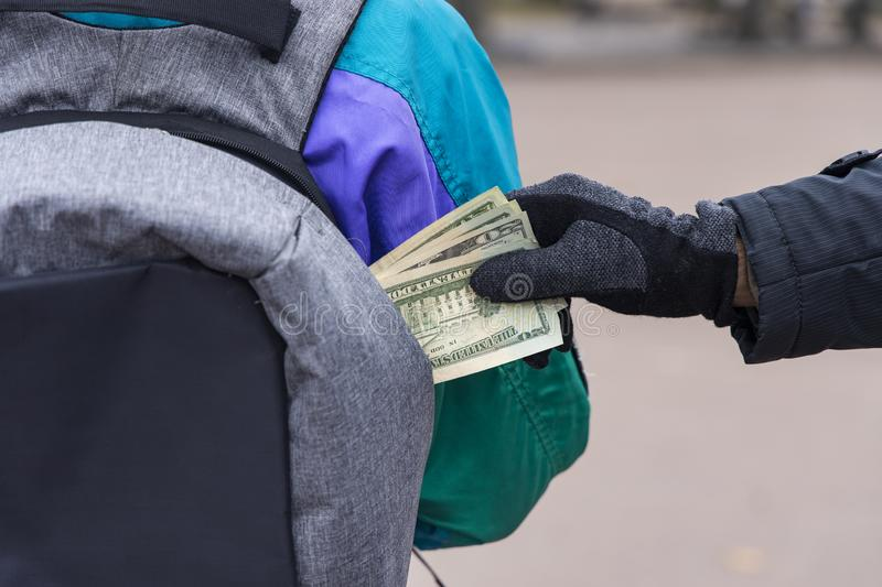 Pocket theft cash money from bag crime man and victim woman incognito people criminal concept royalty free stock photo