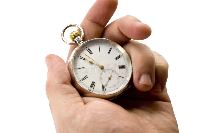 Pocket watch. Isolated hand holding an antique pocket watch royalty free stock photos