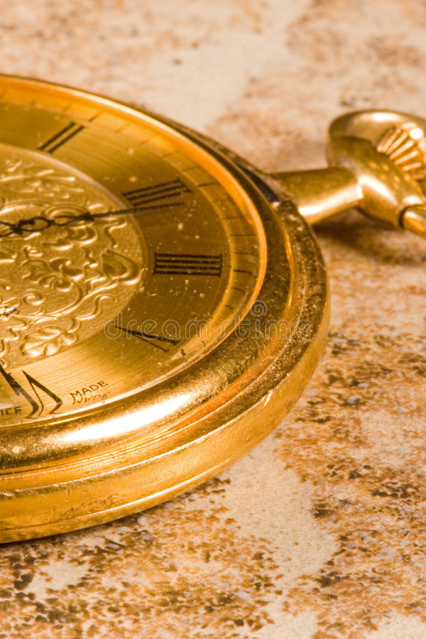 Pocket Watch. Antique gold pocket watch for business stock photos