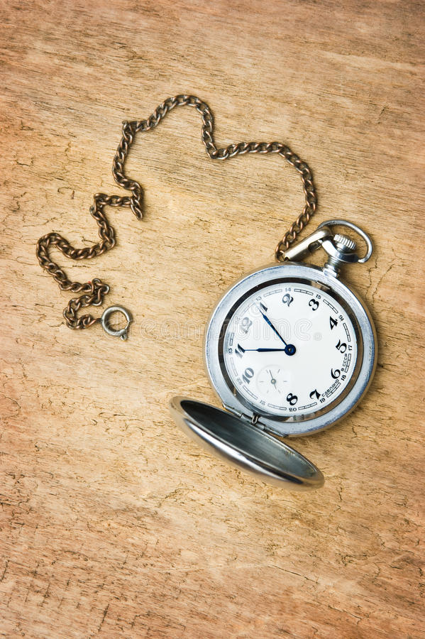 Pocket watch against the  wooden planks