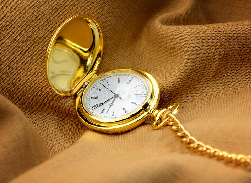 Pocket watch on fabric stock photography