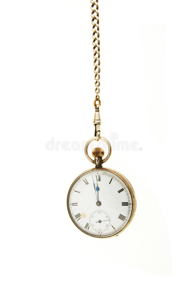 Pocket watch hanging from a chain. Antique pocket watch hanging from a chain against white stock images