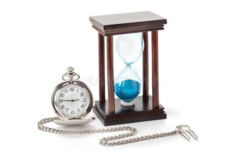 Pocket watch and hourglass. Isolated on white background royalty free stock image