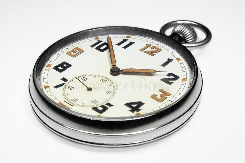 Vintage swiss pocket watch isolated. Vintage swiss pocket watch perspective right isolated on white background stock photography