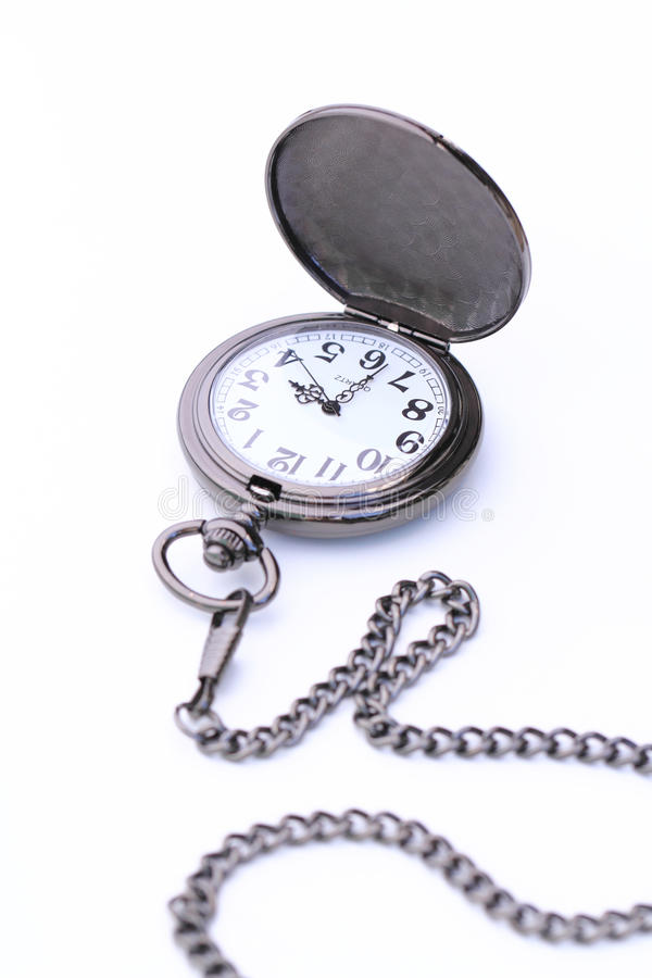 Pocket watch isolated on white background. Pocket watch with its chain isolated on white background stock photography