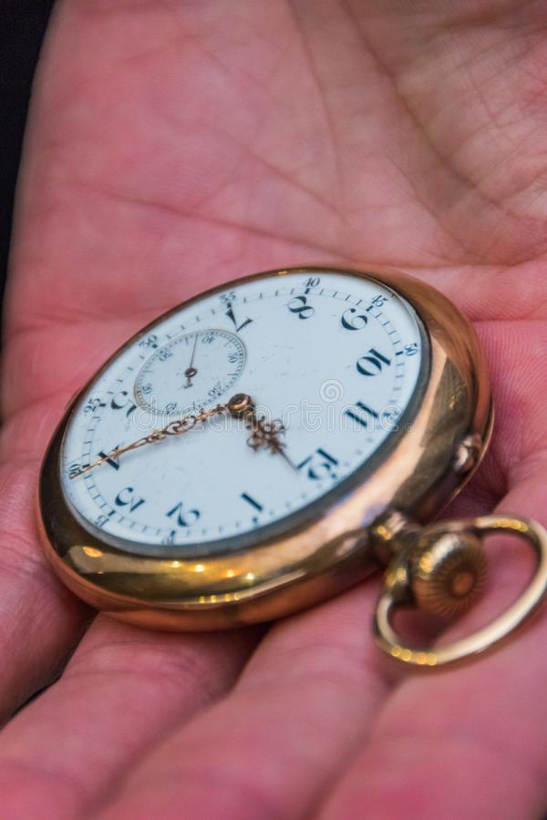 Pocket watch in a man`s hand, close-up stock images