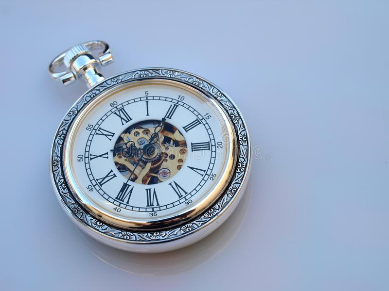 Pocket watch. Over white surface royalty free stock image