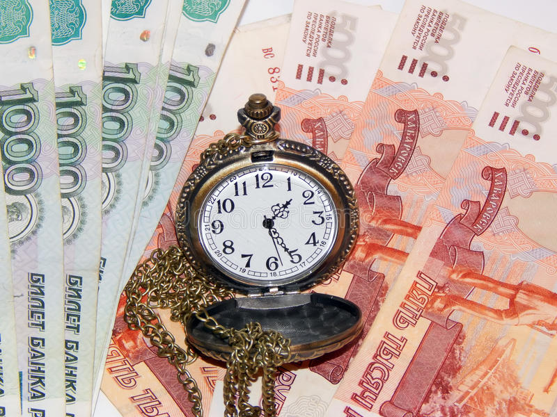 Download Pocket Watch With Russian Money. The Concept Of Time Is Money Stock Photo - Image: 83708277