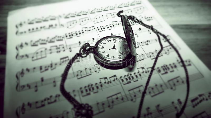 Pocket watch on sheet music