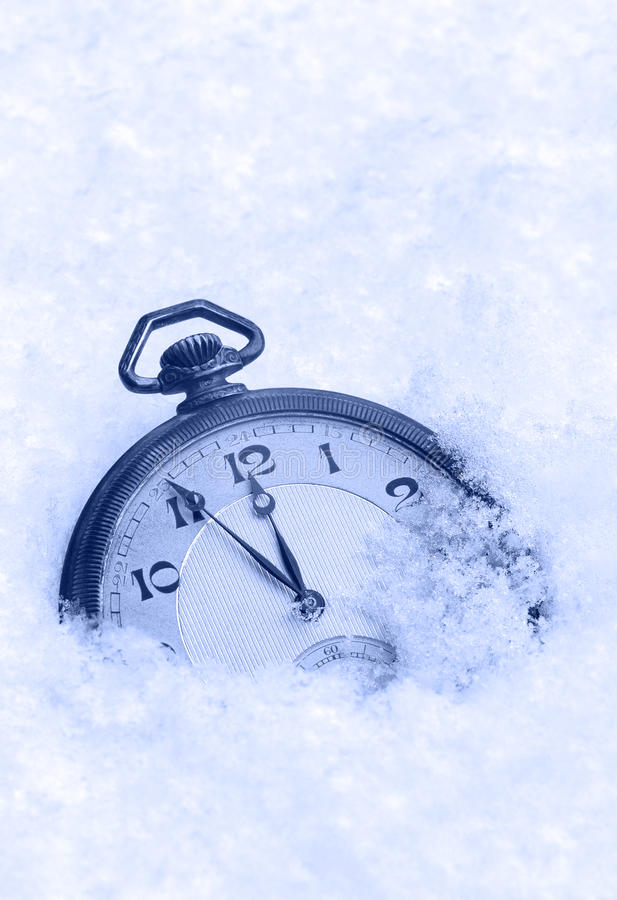 Pocket watch in snow, Happy New Year greeting card. Concept stock images