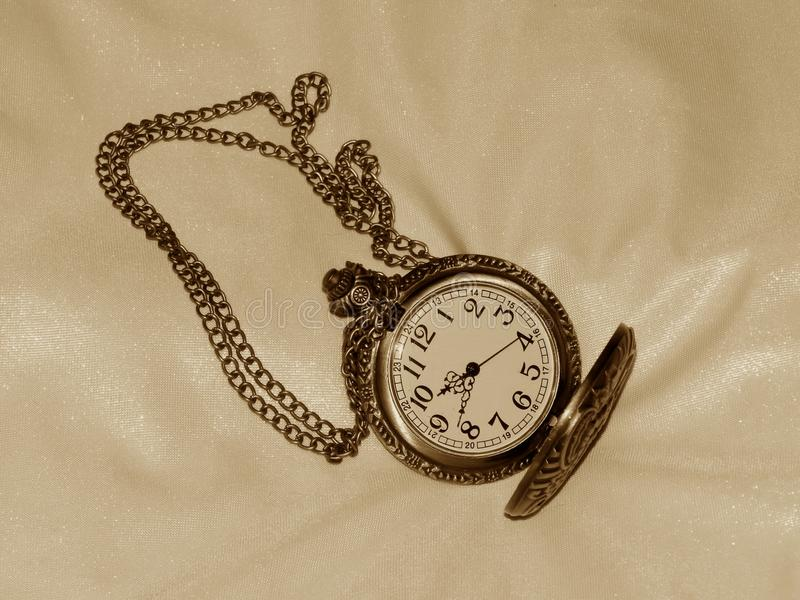 Pocket watch in the style of a retro image stock images