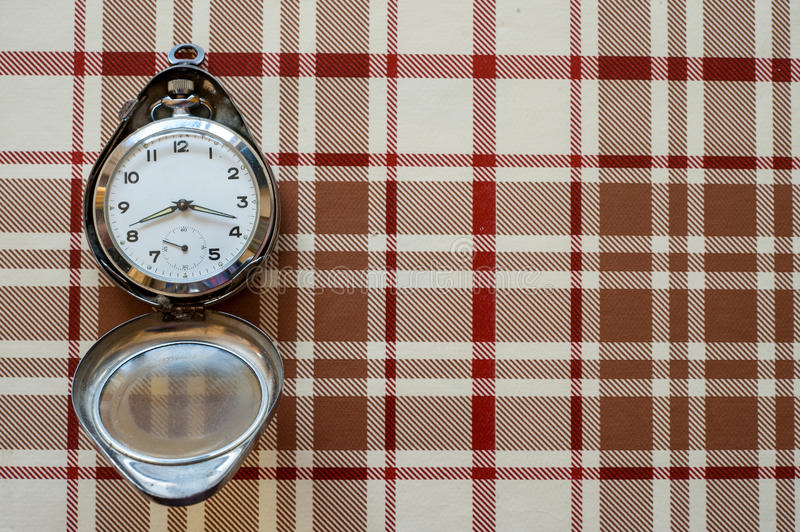 Pocket watch on table cloth. Pocket watch on flannel table cloth stock image