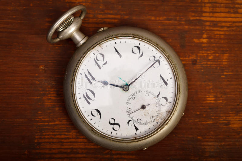 Pocket watch on wood table royalty free stock photos