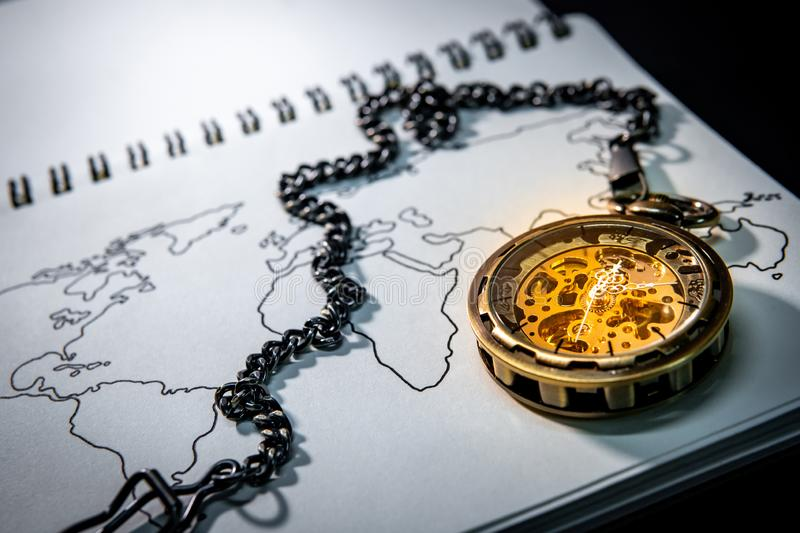 Pocket watch on world map outline sketch royalty free stock photo