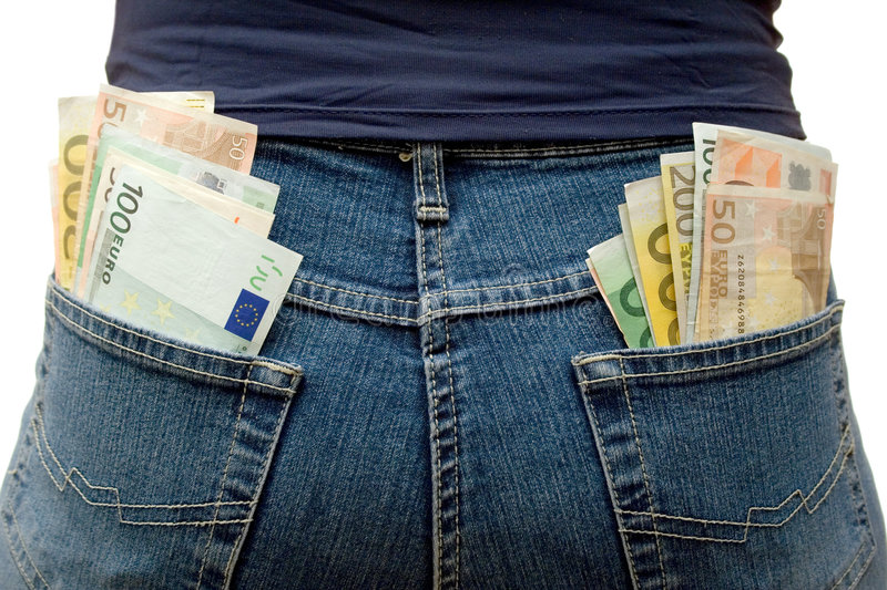 Pockets Full of Money. Blue jeans stuffed with Euro banknotes. White background stock photo