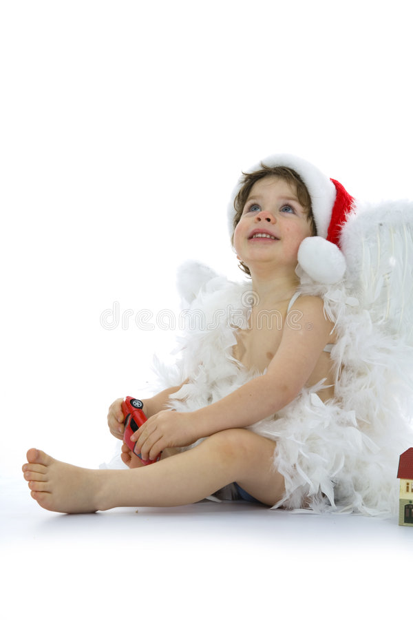 Poco ángel con el coche y la casa foto de archivo libre de regalías