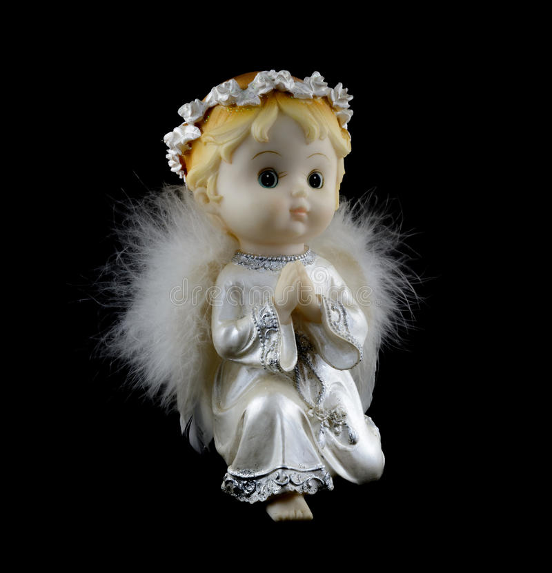 Poco angelo custode isolato su fondo nero Decorazione dell'annata immagini stock libere da diritti