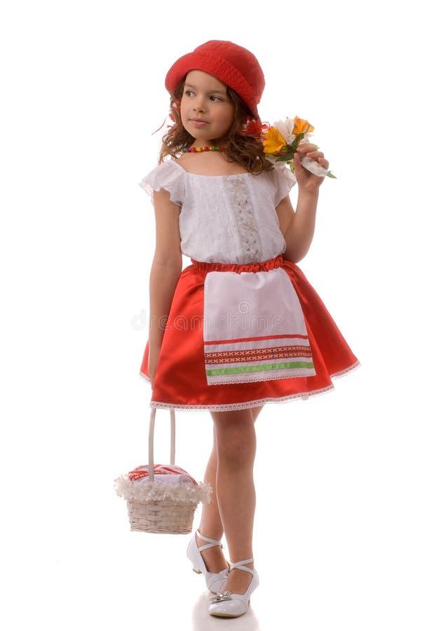Poco cappuccio e fiori di guida rosso fotografia stock libera da diritti