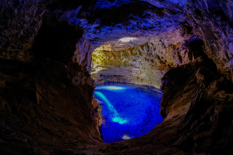 Poco Encantado, blue lagoon with sunrays inside a cavern in the Chapada Diamantina, Andarai, Bahia, Brazil. South America royalty free stock image