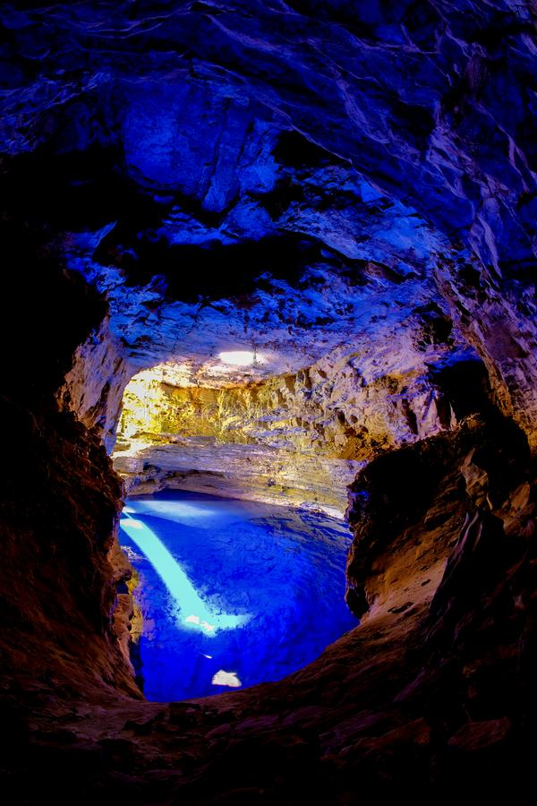 Poco Encantado, blue lagoon with sunrays inside a cavern in the Chapada Diamantina, Andarai, Bahia, Brazil. South America stock image