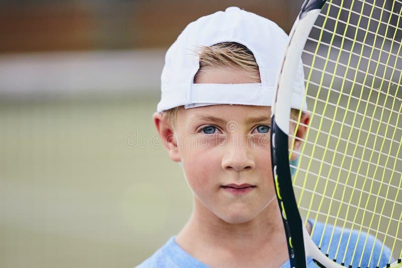 Poco giocatore di tennis fotografia stock