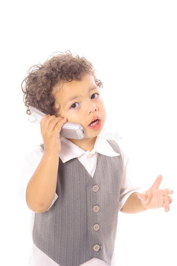 Poco ragazzo di affari che comunica sul cellulare fotografia stock