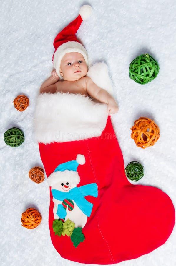 Poco San Nicolás recién nacido en el bootee del Año Nuevo fotografía de archivo