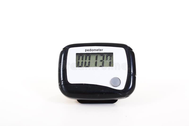 Podómetro para el ejercicio que camina Contador de paso Fondo aislado blanco fotografía de archivo libre de regalías